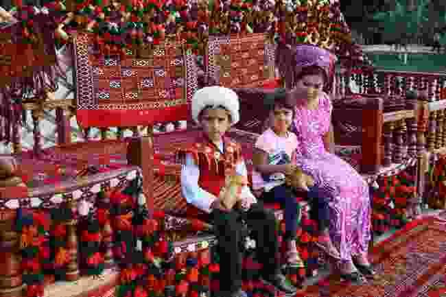 A Turkmen family in Ashgabat, Turkmenistan (Dreamstime)