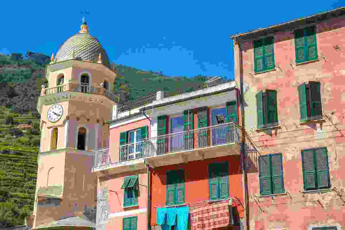 Vernazza's medieval clock tower, which looks over the beach. Cinque Terre, Italy (Shutterstock)