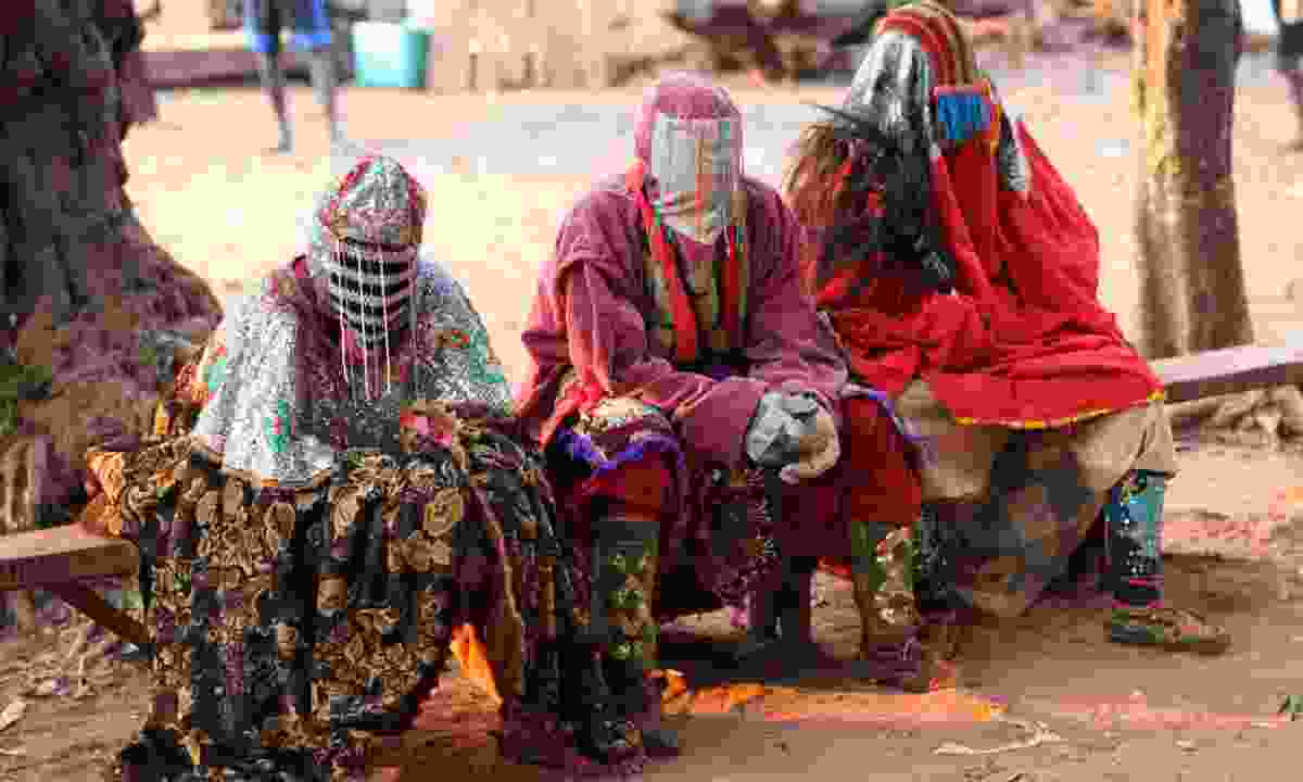 People wearing masks during the Egungun Ceremony, Benin (Shutterstock)