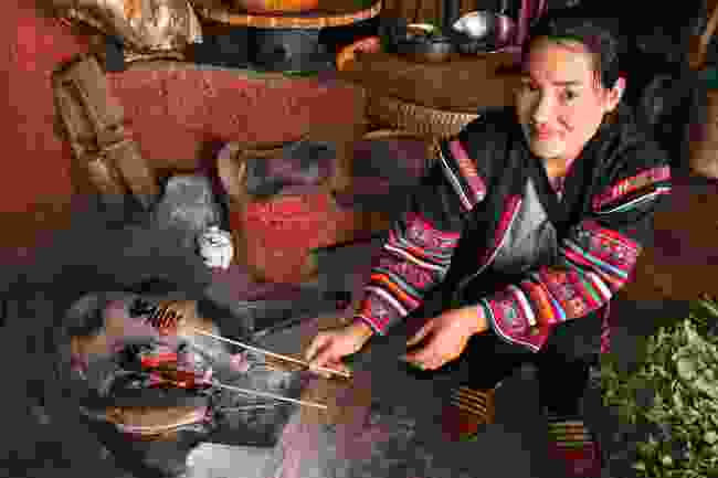 Grilling the locals: In Hloyo village, Phon cooks chillis for the guests (Martin Symington)