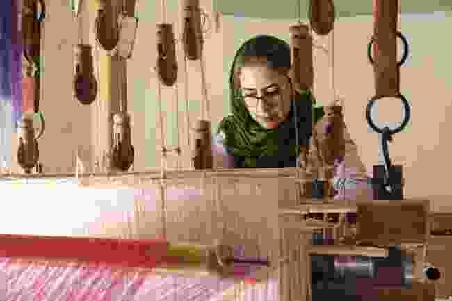 A woman weaving in The Manouchehri House, Kashan (Hamed Farhangi)