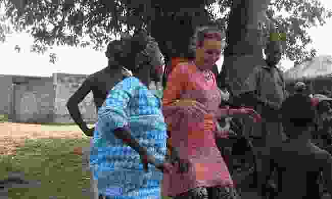 Julie in Benin with the locals (c/o Julie Gabbott)