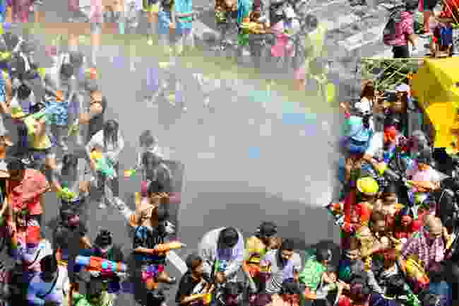 Revellers soak each other for Songkran, on Silom Road, Bangkok (Shutterstock)