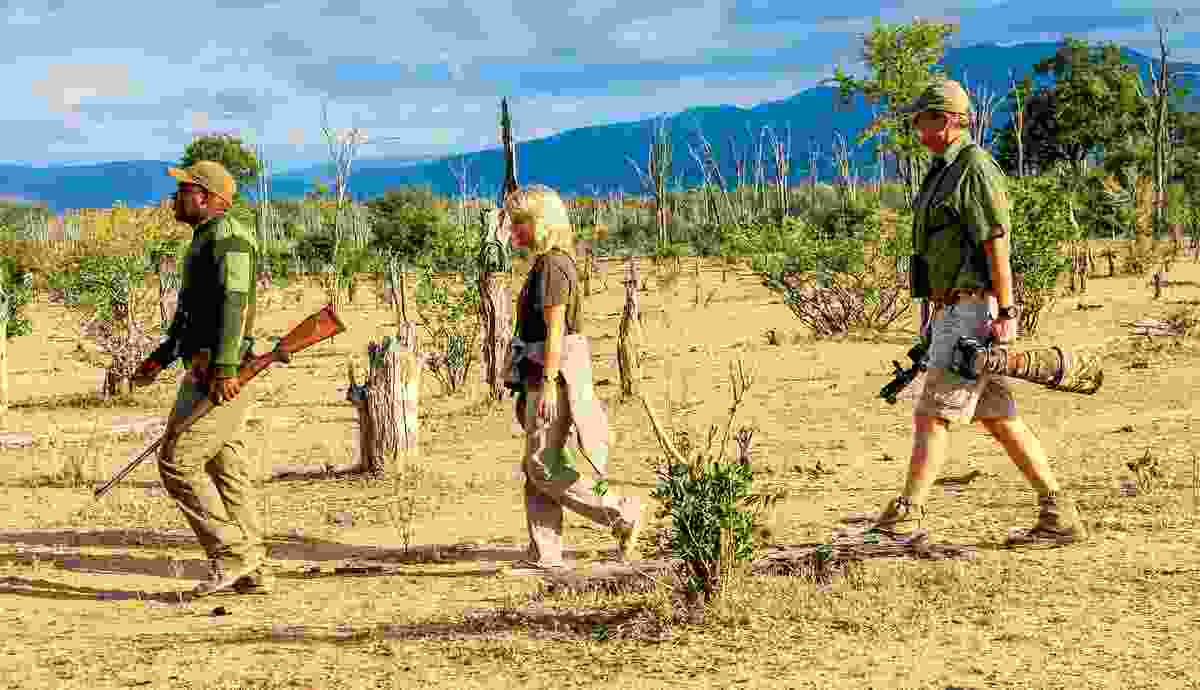 Sue Watt and Nick Dyer on foot in Mana Pools (Will Whitford)