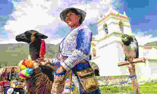 A Quechua woman dressed in traditional clothing (Dreamstime)