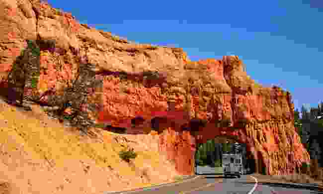Driving through a red canyon tunnel on Utah's All-American Road (Steve Greenwood)