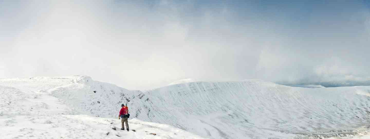 Hiking in the snow on the Brecon Beacons, Wales (Dreamstime)