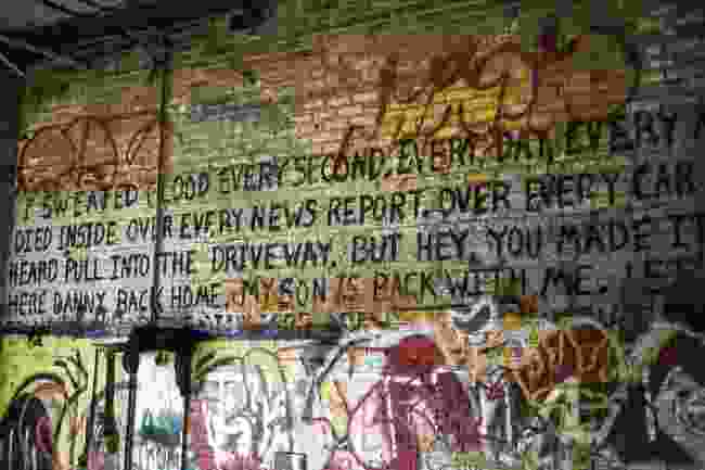 Poetry and writing covers many of the inside walls of the remaining buildings (Lisa Beard)