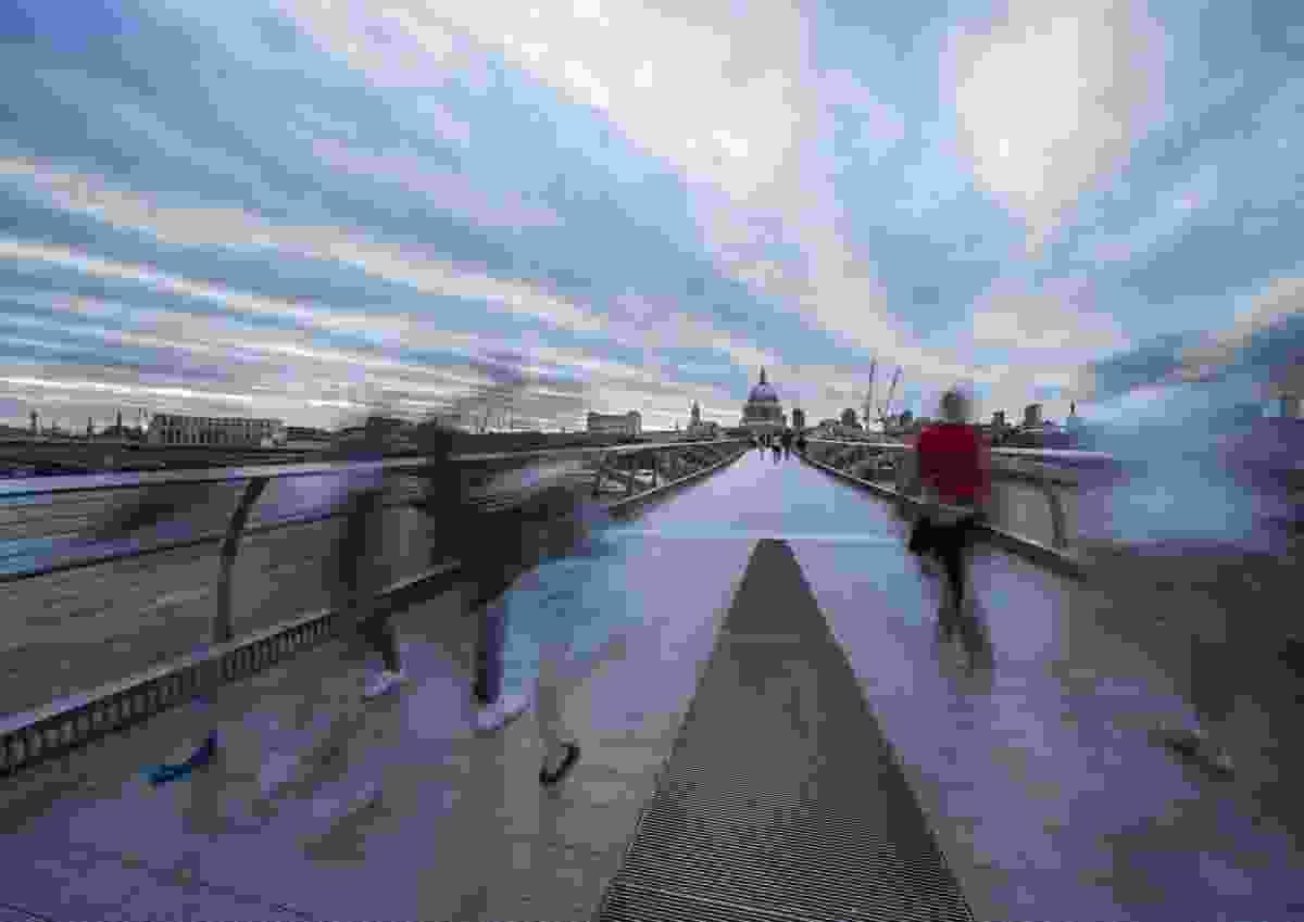 Walking at dusk Millennium Bridge, London, UK (Peter Karry)