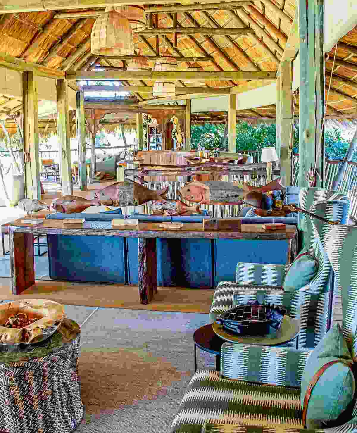 The plush wood and thatch lounge and dining area of Nyamatusi Camp (Will Whitford)