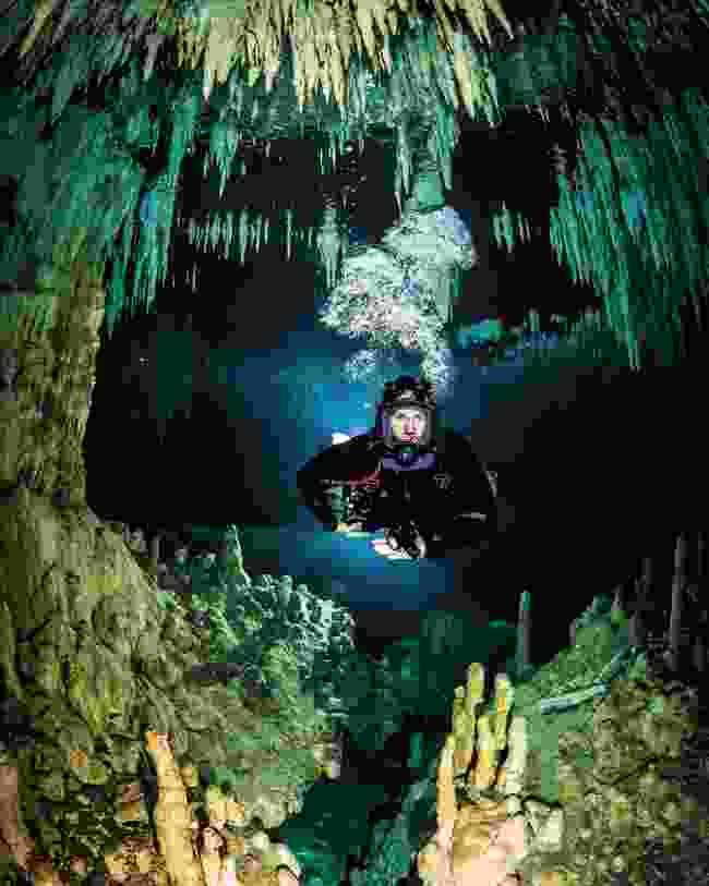 Steve Backshall diving through a cave system (Gabriel Gasca Rubi)