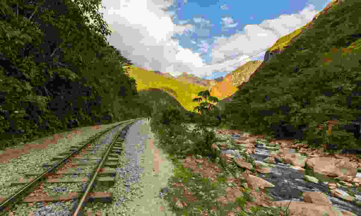 Railroad track crossing jungle in Peru (Shutterstock)