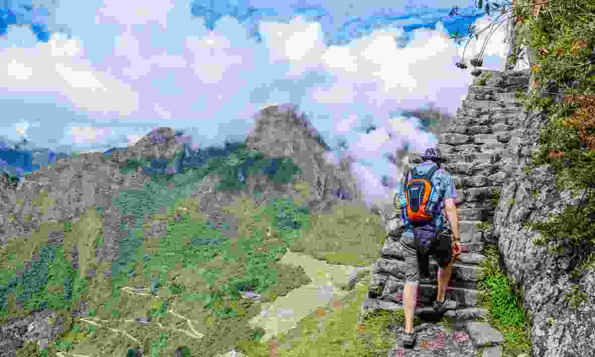 Heading up the Inca Steps (Dreamstime)