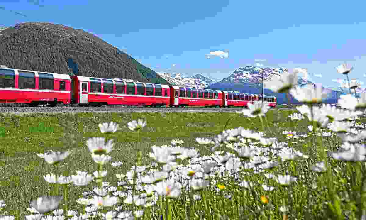 Bernina Express running beside Lake Bianco (Rhaetische Bahn)