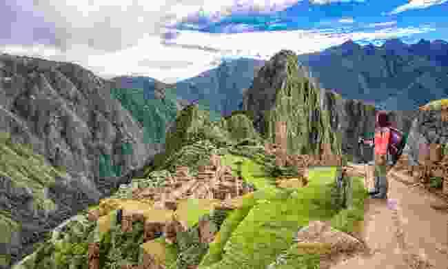 A solo traveller looking over Machu Picchu (Shutterstock)