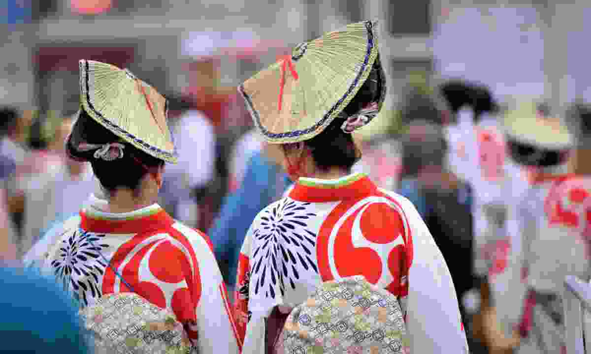 See people im traditional dress at Gion Matsuri festival (Shutterstock)