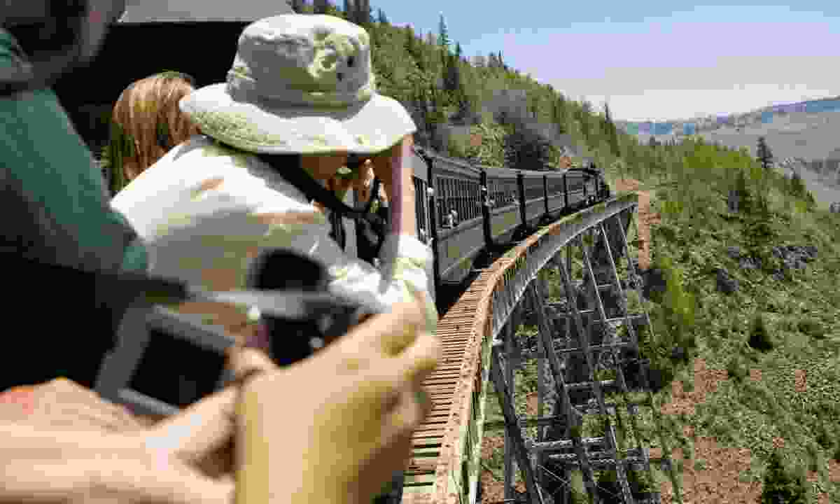 Passengers taking photos from the Cumbres and Toltec Railroad (Denise Chambers & Miles)