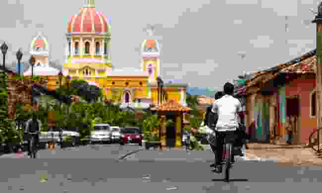 Cycling through the streets of Granada, Nicaragua (Dreamstime)