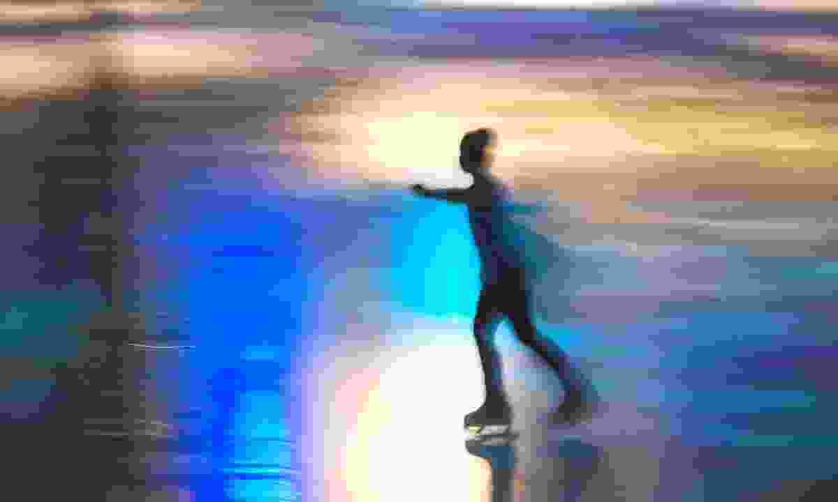 Girl skating on rink (Dreamstime)