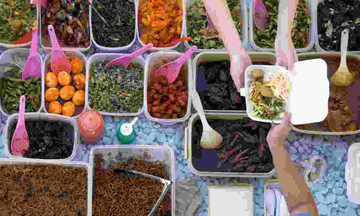 Food stall at a Kota Kinabalu market. (Dreamstime)