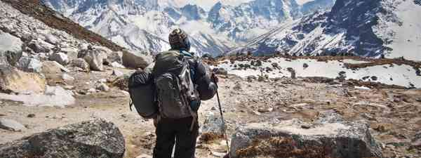 Trekker arriving at Everest Base Camp (Dreamstime)
