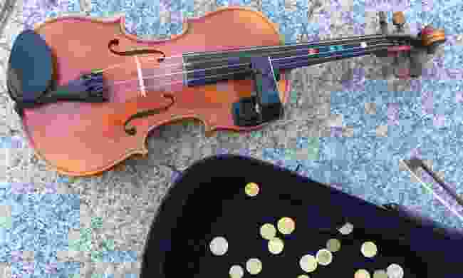 Alastair's violin and his daily takings (Alastair Humphreys)