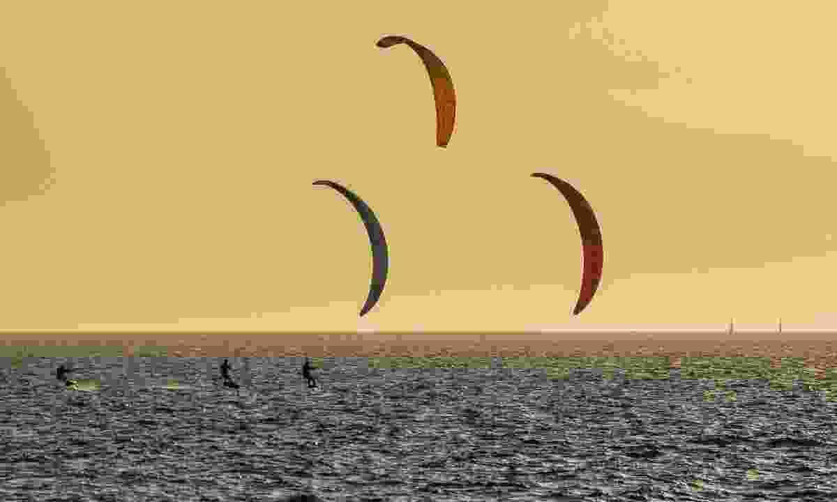 Kitesurfers at sunset in front of Fremantle beach (Shutterstock)
