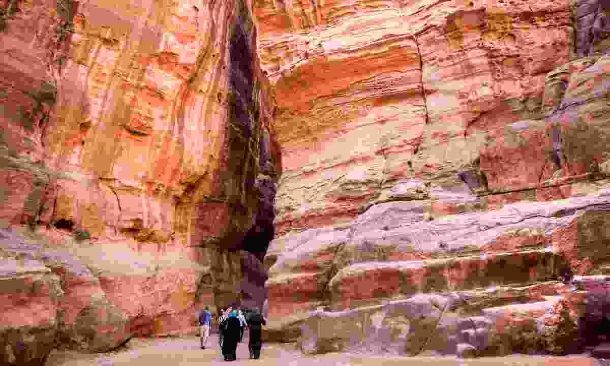 Wind through the Siq ravine to discover Petra's temples (Dreamstime)