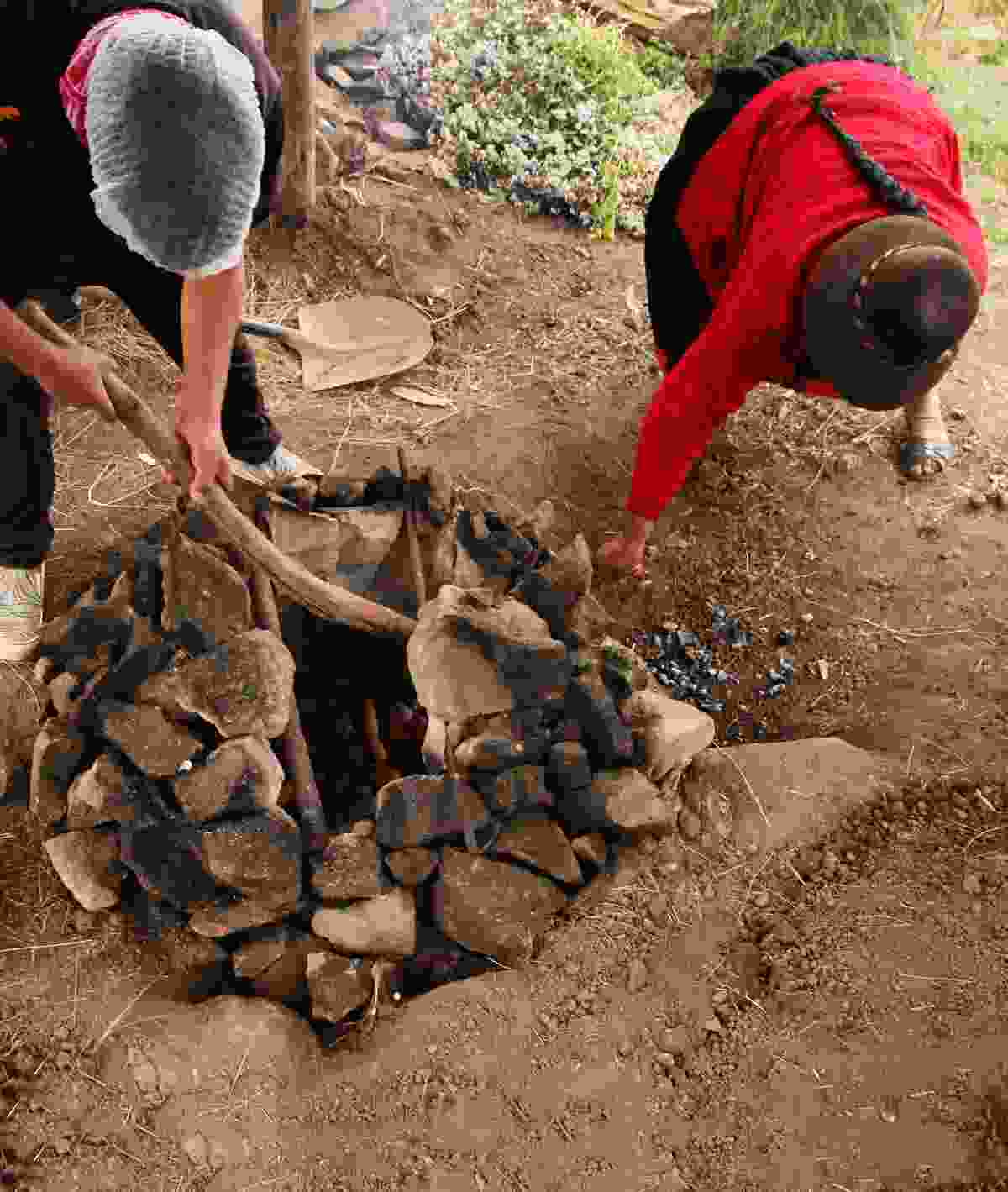 Ingredients for a pachamanca feast are buried in a pit with heated stones (Paul Bloomfield)