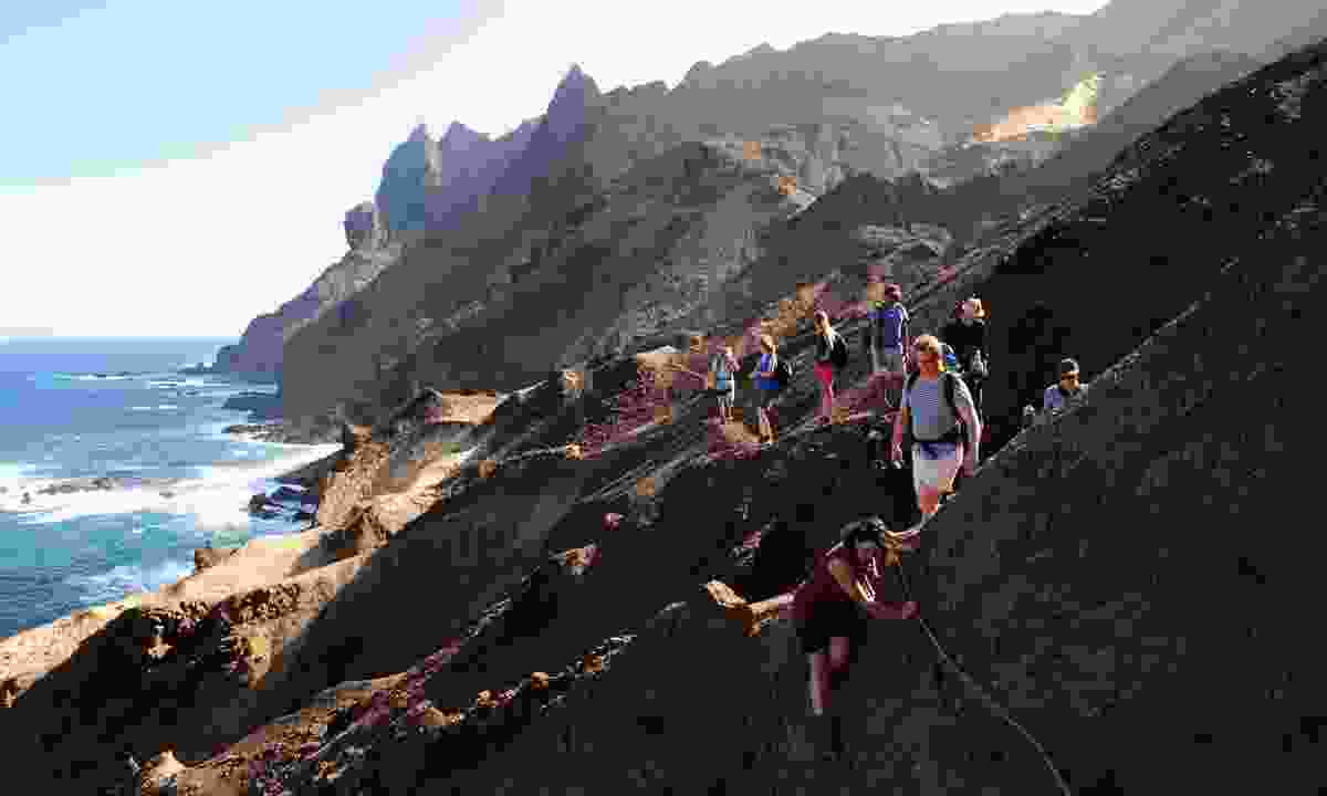 People scrambling over the last part of the hike to Lot's Wife Bay (St Helena Tourist Board)