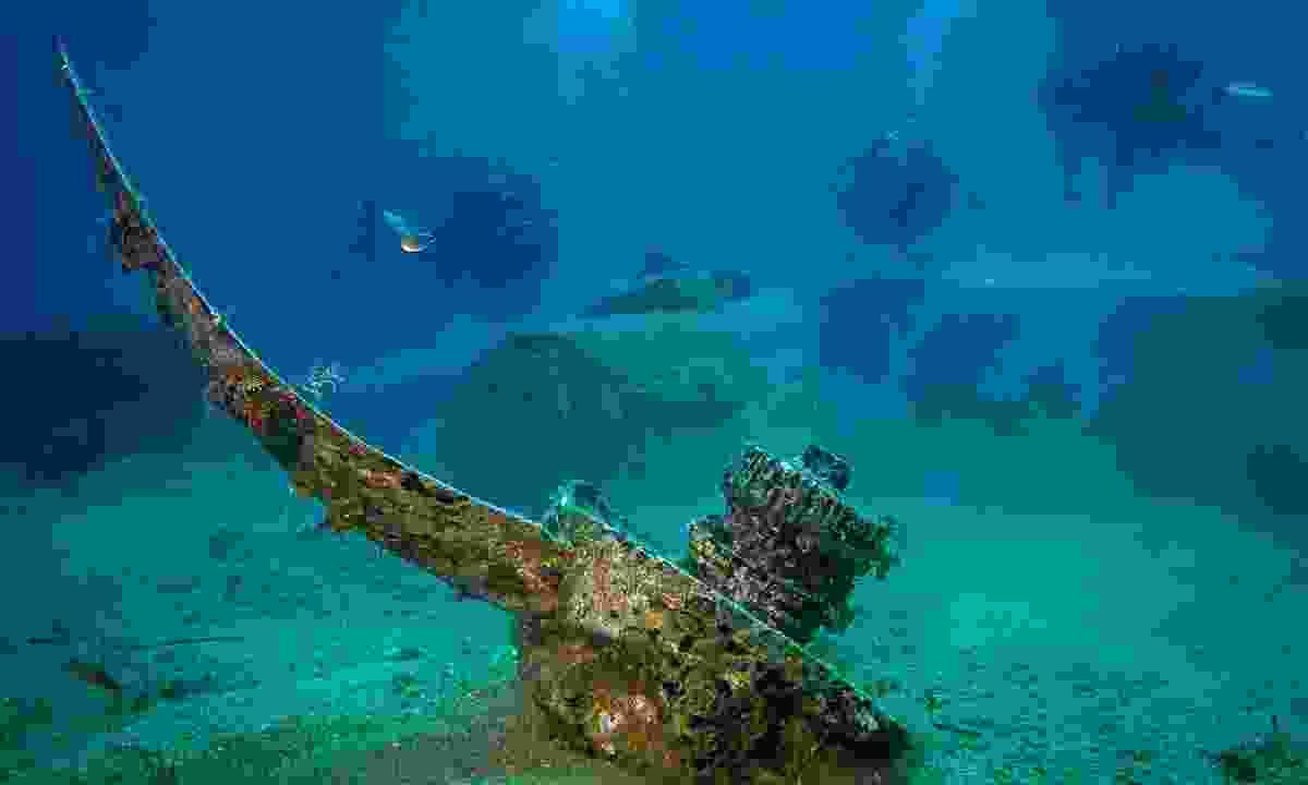 Divers exploring a sunken plane in Crete