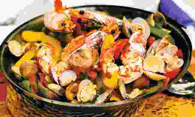 The delicious seafood medley that is cataplana - a feast of shellfish in a bowl (Shutterstock)