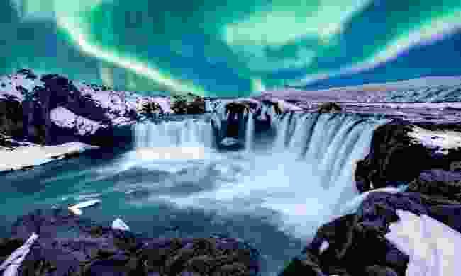 The Northern lights over Goðafoss (Shutterstock)