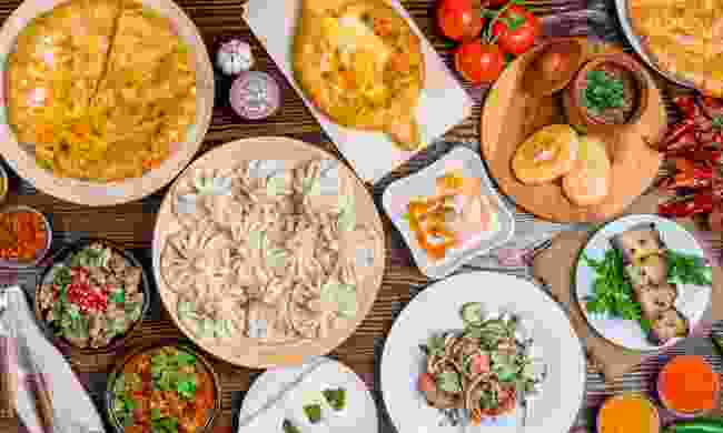 Traditional Georgian cuisine, including khachapuri, khinkali, pkhali, dolma and satsivi  (Shutterstock)