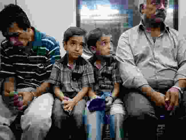 Young twins on the Tehran Metro (Amos Chapple)
