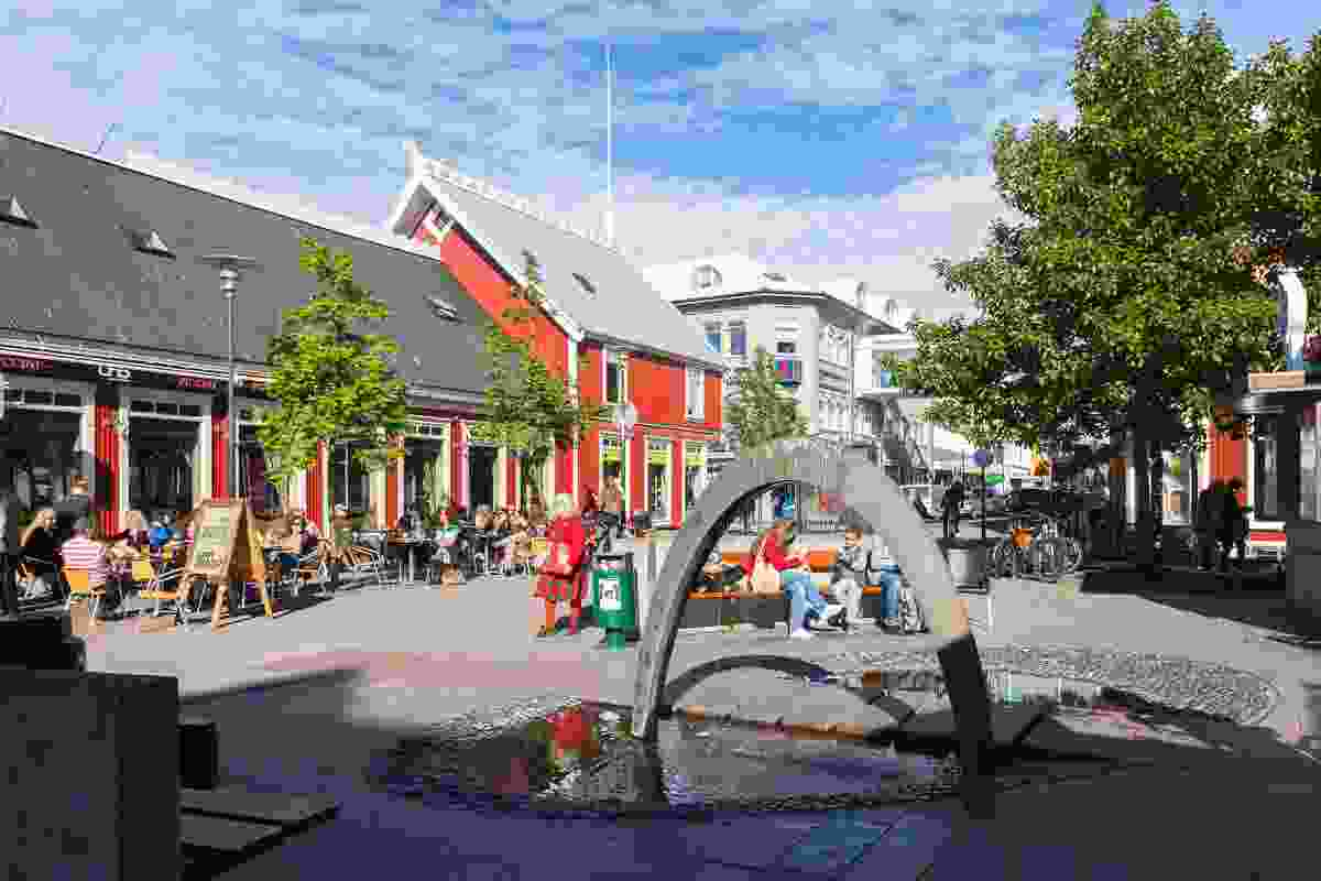 Ingólfur Square in Reykjavik, home to shops, cafes, street food stands and sporting events on TV in the summer (Dreamstime)