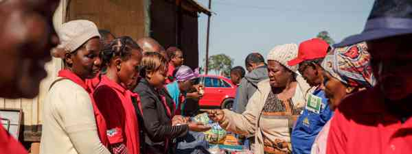 Buying and selling at a local market (Allan Dransfield)