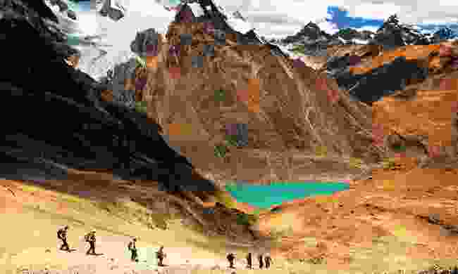 Tekking among the emerald pools and towering peaks of the Cordillera Huayhuash (Shutterstock)