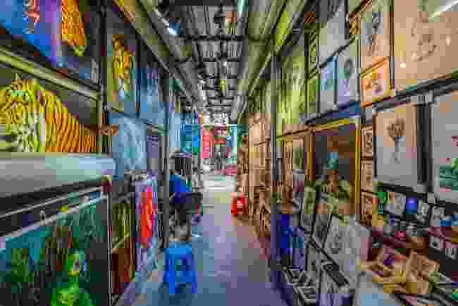 One of the art-lined corridors of Dafen Oil Painting Village (Shutterstock)