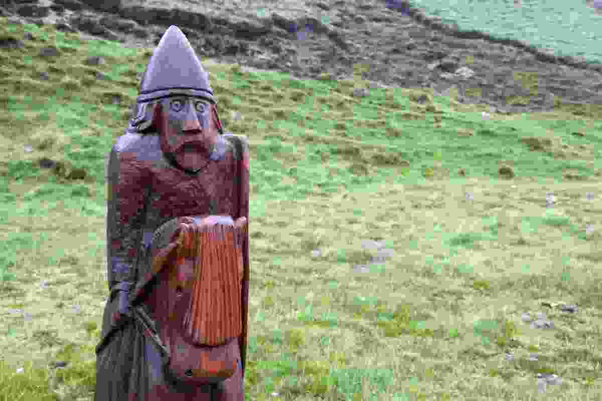The Knight, wooden sculpture of one of the Lewis Chessmen, at entrance to Abhainn Dearg Distillery, Carnish, Lewis (Graeme Green)
