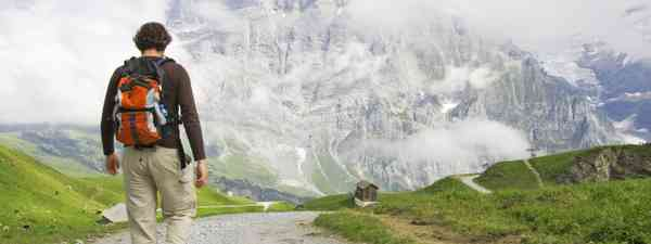 Young man walking in the Swiss Alps (Dreamstime)