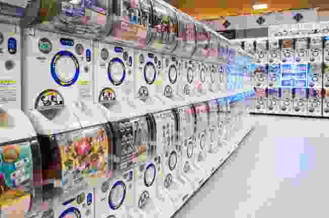 Rows of 'Gashapon' machines in a Kyoto department store. These popular vending machines dispense capsules with manga figurines (Shutterstock)