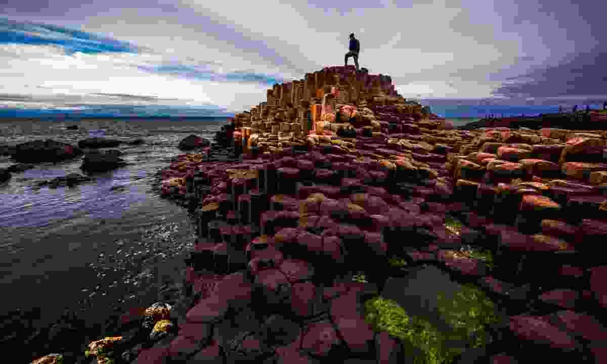 Man atop Giant's Causeway (Shutterstock)
