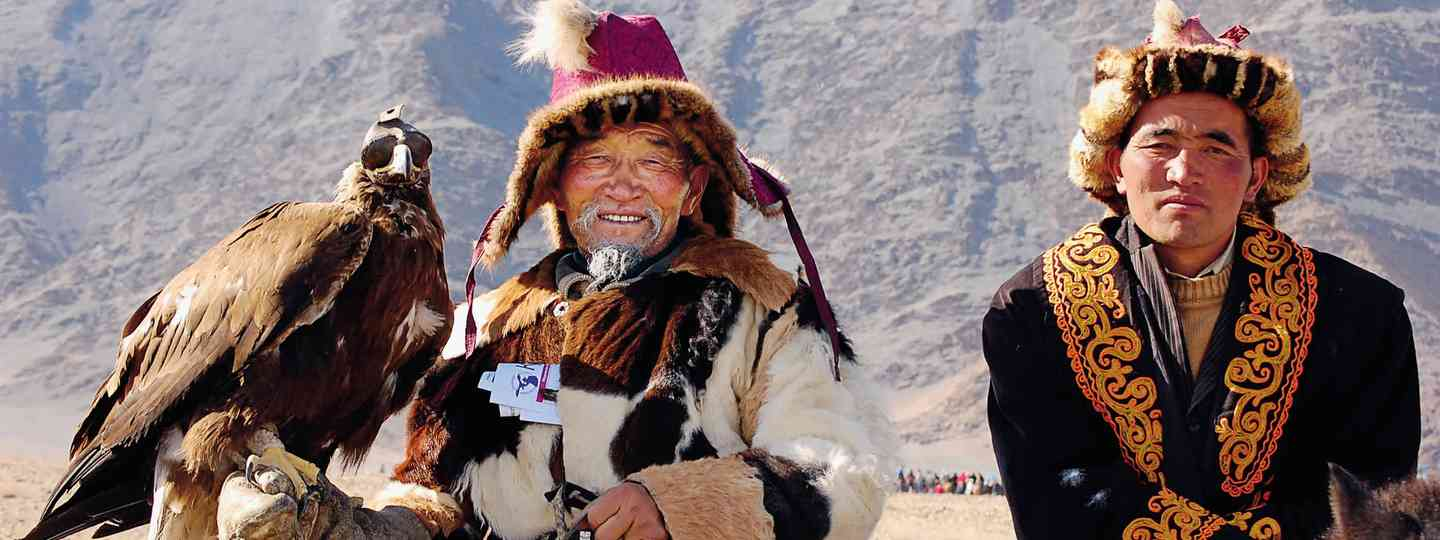 Mongolian eagle and native Mongolians (Exodus Travel)
