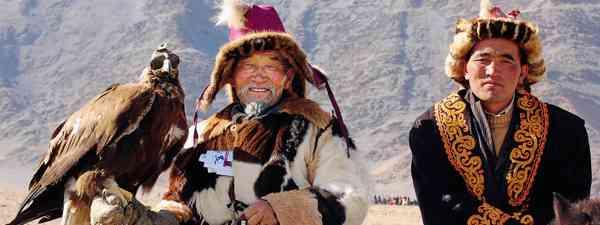 Mongolian eagle and native Mongolians (Exodus Travel)