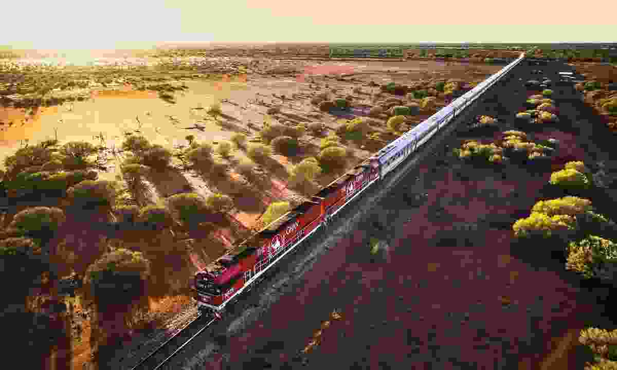 The Ghan travelling through the outback (Journey Beyond Rail)