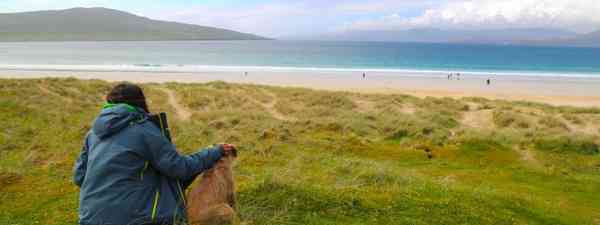 Traveller and dog looking out over Luskentyre beach (Graeme Green)