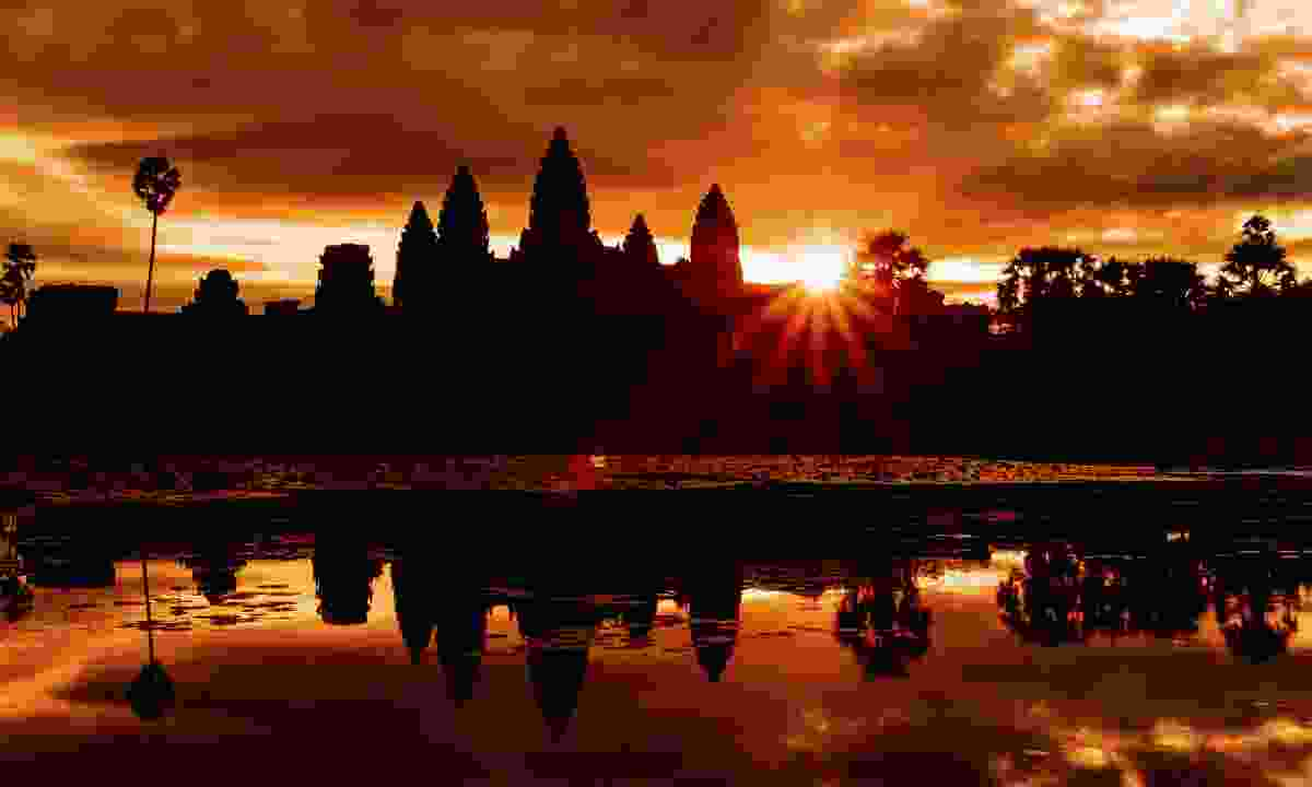Sunrise over Angkor Wat - a popular time for visitors looking for atmospheric shots (Shutterstock)