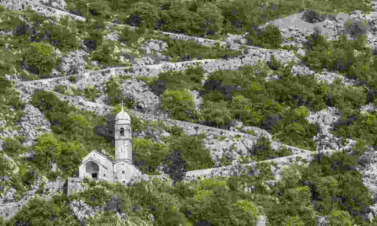 Trail zig-zagging behind Kotor (Dreamstime)