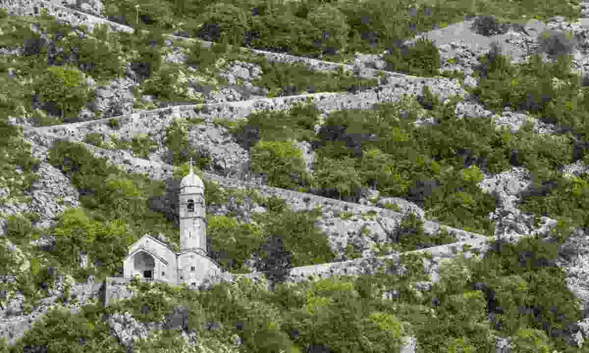 Trail zig-zagging behind Kotor (Dreamstime)